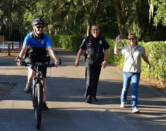 Officer on Bike and Officer and Official Walking
